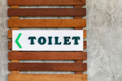 Toilet sign on wall surface Royalty Free Stock Photography