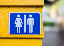 Toilet sign. On wall yellow background Royalty Free Stock Image