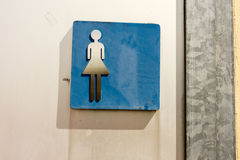 Toilet sign women. Old in washed out blue Royalty Free Stock Images