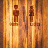 Toilet sign on wood wall Royalty Free Stock Photo