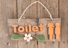 Toilet sign. Wooden toilet sign with rope for hanging Stock Image