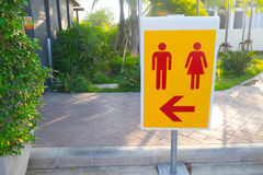 Toilet sign yellow male and female icon. In public garden Royalty Free Stock Photos