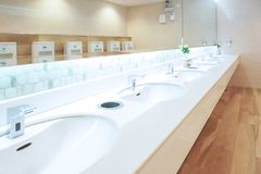 Toilet sink interior of public toilet with of washing hands and mirror stock photo