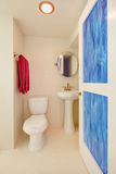 Toilet and sink in a new white bathroom. Stock Photography