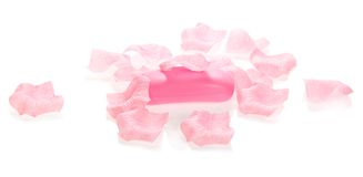 Toilet soap under petals of the roses Royalty Free Stock Photo