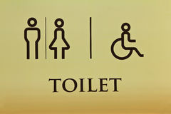 Toilet and symbol Royalty Free Stock Images