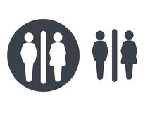 Toilet symbols  on white background. White silhouettes in a dark grey circle and dark grey male and female icon on white backgroun Stock Images