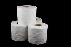 Toilet Tissue Rolls on Black Background Stock Photos