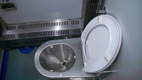 Toilet in a Train Carriage. Metal Toilet in a moving train. WC stock video