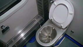 Toilet in a Train Carriage. Metal Toilet in a moving train. WC stock footage