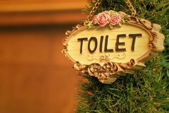 Toilet vintage label on a brown background. Royalty Free Stock Photos