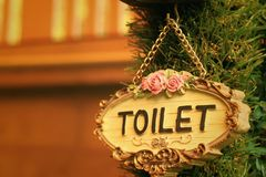 Toilet vintage label on a brown background. Stock Images