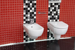Toilet WC and bidet. Photo of a new toilet WC with colored tiles royalty free stock photos