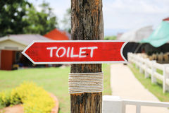 Toilet wood arrow sign Royalty Free Stock Photo