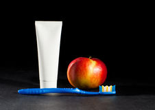Toiletries and apple Royalty Free Stock Photography