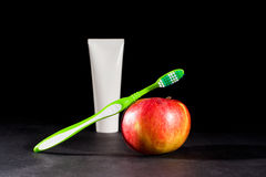 Toiletries and apple Stock Image