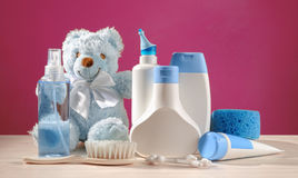 Toiletries baby. Blue items and pink background Royalty Free Stock Photos