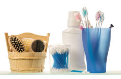 Toiletries, glass with toothbrush and toothpaste isolated on white. Royalty Free Stock Images