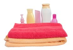 Toiletries with pink towel Royalty Free Stock Photography