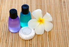 Toiletries and plumeria flower. Toiletries with soap and plumeria flower for tropical spa concept Royalty Free Stock Photos