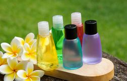 Toiletries and plumeria flower. Toiletries with soap and plumeria flower for tropical spa concept Stock Photo