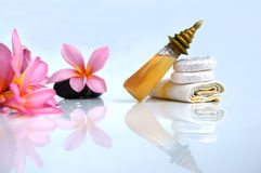 Toiletries with plumeria flower and soap. For tropical spa concept, isolated on white background Stock Photos