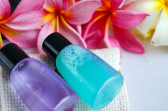 Toiletries with plumeria flower and towel Stock Images