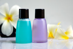 Toiletries with plumeria flower and towel Royalty Free Stock Photos