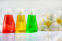 Toiletries with plumeria flower and towel Royalty Free Stock Photo