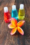 Toiletries and plumeria flower on wood floor Royalty Free Stock Images