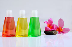 Toiletries with plumeria flowers. Toiletries with plumeria flower for tropical spa concept, isolated on white background Stock Photography