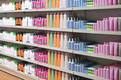 Toiletries retail shelves. Colorful toiletries plastic bottles in retail store shelves royalty free stock photo