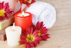 Toiletries Set with Towel, Candles and Flowers Royalty Free Stock Images