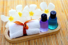 Toiletries with towel. And plumeria flower bamboo mat Stock Photography