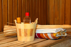 Toiletries and towels on shelf in sauna Royalty Free Stock Images