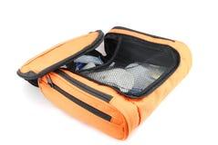 Toiletry bag. Open orange toiletry bag isolated on white background Stock Image