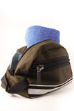 Toiletry bag. Brown toiletry bag with blue towel Stock Photos