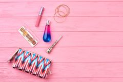 Toiletry bag and accessories, copy space. Fashion women cosmetics bag. Make up products on pink wooden background. Female beauty and style Royalty Free Stock Photography
