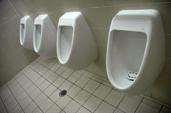 Toilets. Four mans toilets, airport restroom, all white Stock Photography