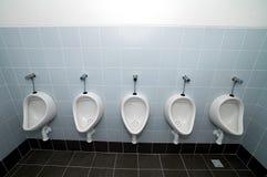 Toilets. White man toilets, tiles on floor and walls Royalty Free Stock Photo