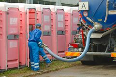 Toilets Being Cleaned. HODONIN, CZECH REPUBLIC - AUGUST 17: Cleaning of the mobile toilets at Made of Metal, August 17th 2014 royalty free stock images