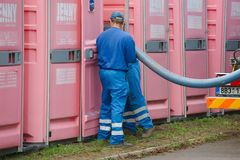 Toilets. HODONIN, CZECH REPUBLIC - AUGUST 17: Cleaning of the mobile toilets at Made of Metal, August 17th 2014 stock photos