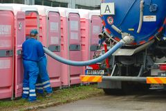 Toilets. HODONIN, CZECH REPUBLIC - AUGUST 17: Cleaning of the mobile toilets at Made of Metal, August 17th 2014 royalty free stock photos