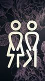 Toilets icon. Style is flat symbol, white color, rounded angles, flower background. royalty free stock photos