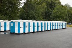 Toilets installed at a public event. Long row of mobile toilets stock photography
