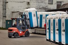 Toilets installed at a public event. VIZOVICE, CZECH REPUBLIC - JULY 12, 2017: Installing many portable toilets for the Masters Of Rock festival beginning the stock photo