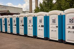 Toilets installed at a public event. VIZOVICE, CZECH REPUBLIC - JULY 12, 2017:Long row of portable toilets for the Masters Of Rock festival beginning the next stock photos