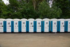 Toilets installed at a public event. VIZOVICE, CZECH REPUBLIC - JULY 12, 2017:Long row of portable toilets for the Masters Of Rock festival beginning the next stock photo