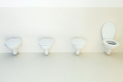 Toilets in a row Royalty Free Stock Image