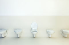 Toilets in a row Stock Photo